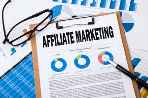 affiliate marketing analysis concept on clipboard