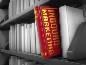 Inbound Marketing - Red Book on the Black Bookshelf between white ones.